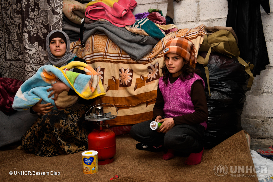 "Um Ahmad, a displaced woman from east Aleppo, heats some water to prepare milk for her newly born baby with a help from her daughter. Um Ahmad gave birth a week ago in poor and cold conditions inside her room at Jibreen collective shelter, ""I covered the concrete walls with blankets in order to keep some warmth inside the room,"" Um Ahmad said. Given the bitter winter conditions, UNHCR and partners are focusing on providing the displaced families in collective shelters with means that bring them some warmth. Over 261,000 people have received aid across Aleppo via the distribution of heaters, blankets, mattresses, winter clothes, insulation kits, family tents, carpets, sleeping bags and jerry cans. Much more is needed to help weather the freezing conditions in the city. ; The brutal fight for Aleppo, which lasted over four years, ended last month when government-backed forces re-established control over the ancient city, and evacuations of citizens were arranged. There are now tentative hopes that the warring sides will engage in peace talks to end the broader civil war. Among the estimated 1.5 million people now in Aleppo, UN agencies have access to about 400,000, the same number that are estimated as displaced in the city. Some families have settled with friends and family. However, many thousands are sheltering in damaged buildings or informal settlements. UNHCR, other UN agencies and partners have been focusing on immediate assistance. The priorities are shelter, food, fuel, winter clothing, water and sanitation, medical support and civilian protection for a population scarred by years of conflict."